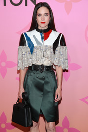 Jennifer Connelly arrived for the Louis Vuitton X: An Immersive Journey carrying a black leather purse from the brand.