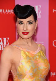 Dita Von Teese attended the 2019 Love Ball III wearing this retro updo.