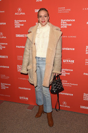 Chloe Sevigny showed off her winter style with this nude Coach suede and shearling coat layered over a ruffled turtleneck at the Sundance Film Fest premiere of 'Love & Friendship.'
