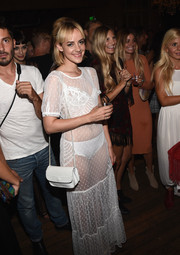 Jena Malone accessorized with a white leather shoulder bag to match her sheer dress at the Skivvies party.