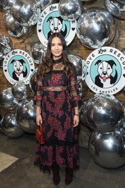 Olivia Munn attended Love Leo Rescue's Cocktails for a Cause wearing a  Giambattista Valli floral dress with sheer lace panels.