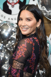 Olivia Munn attended Love Leo Rescue's Cocktails for a Cause wearing a center-parted wavy 'do.