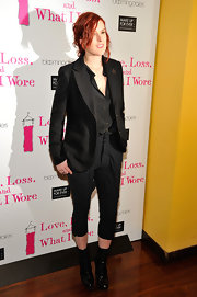 Rumer Willis accented her menswear attire with a pair of studded black patent mid-calf lace up boots.
