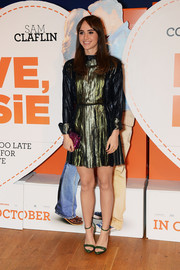Keeping up the metallic theme, Suki Waterhouse paired her dress with green ankle-strap sandals.
