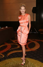 Sharon's peach satin sheath may have looked classic but its pocket detailing and black piping added modern elements.