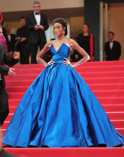 Winnie Harlow was a stunner at the Cannes Film Festival screening of 'Loveless' wearing this strapless electric-blue ball gown by Zuhair Murad Couture.