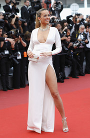 Petra Nemcova flashed major leg at the Cannes Film Festival screening of 'Loveless' in a white The 2nd Skin Co. gown with a hip-high slit and a plunging neckline.