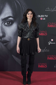 Penelope Cruz went tough in a studded black leather jacket by Versace for the 'Loving Pablo' photocall in Madrid.