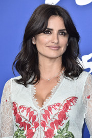 Penelope Cruz looked sweet with her center-parted waves at the Venice Film Festival photocall for 'Loving Pablo.'