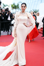 Sonam Kapoor showed off her shapely figure in a Ralph & Russo Couture form-fitting nude gown with a flower-appliqued cape at the Cannes premiere of 'Loving.'