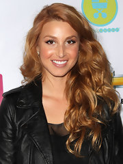 Whitney Port attended the Lucky Shops event in LA sporting strawberry blond tresses. Her warm hue and flowing curls perfectly complement her radiant complexion.