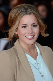 Caggie Dunlop had her tresses tied in a messy updo for a movie premiere.