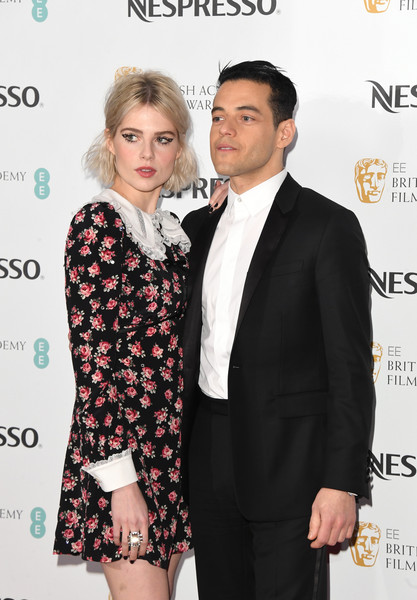 Lucy Boynton Statement Ring [suit,event,fashion,formal wear,premiere,tuxedo,dress,carpet,white-collar worker,smile,nespresso,red carpet arrivals,rami malek,lucy boynton,british academy film awards,england,london,kensington palace,nominees party,nominees party]
