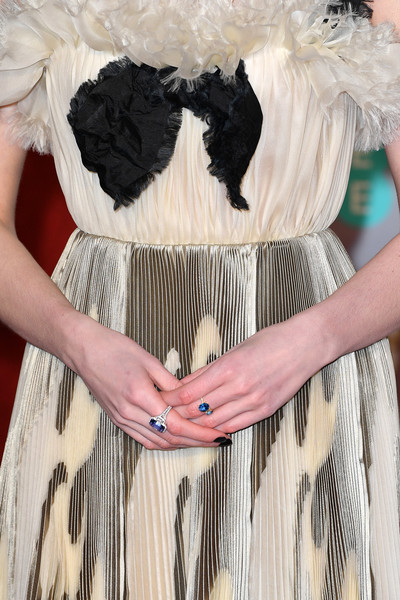 Lucy Boynton Gemstone Ring [white,clothing,black,dress,waist,cocktail dress,fashion,beige,abdomen,fur,red carpet arrivals,lucy boynton,dress detail,ee,england,london,royal albert hall,british academy film awards]