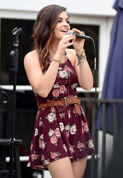 Lucy Hale performed at Hollister House wearing a floral romper cinched with a woven-leather belt.