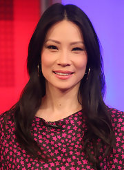 Lucy Liu kept her mane low key with a center part hairstyle that showed off her polished layers.