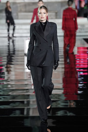 Doutzen Kroes was masculine-chic in a black pantsuit by Ermanno Scervino at the LuisaViaRoma CR runway show.