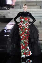 Lara Stone looked OTT in a floral-beaded gown with a latex yoke and sleeves and a voluminous tulle train at the LuisaViaRoma CR runway show.