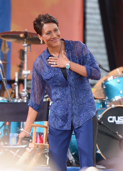 Robin Roberts layered a sheer blue button-down shirt over a black camisole for a laid-back yet chic finish.