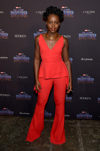 Lupita Nyong'o Wide Leg Pants [flooring,shoulder,carpet,fashion model,fashion,red carpet,electric blue,formal wear,joint,fashion design,lupita nyongo,new york city,marvel studios,industria studios,wakanda new york fashion week,black panther welcome,showcase]