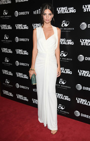 Emily Ratajkowski looked alluring in an asymmetrical white gown by Narciso Rodriguez at the New York screening of 'Lying and Stealing.'