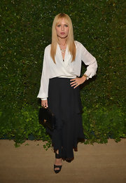 Rachel Zoe may have kept her look classic with a black and white combo, but she certain retained her signature boho-chic style with this draped white blouse.