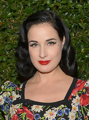 Dita chose a vibrant red lip to give her just another touch of glamour!