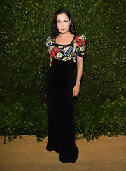 Dita Von Teese rocked her signature retro style at 'Vogue' and MAC's dinner party where she wore this black velvet gown that featured a floral bodice and puffed sleeves.