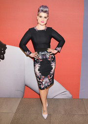 Kelly Osbourne kept it classy in a black sheath with a floral skirt during the launch of her MAC collection.