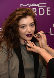 Lorde finished off her look with a sweep of dark purple lipstick.