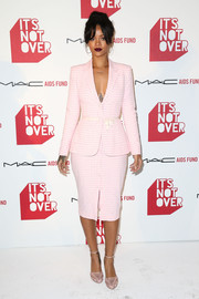 Rihanna teamed her suit with a pair of pink cutout pumps, also by Altuzarra.