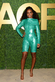 Kelly Rowland was a standout in her aqua-green sequined romper at the MACRO pre-Oscar party.