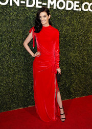 Lydia Hearst chose a one-sleeve red Monse gown with a ruched waist and a high side slit for the MAISON-DE-MODE sustainable style celebration.
