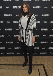 Caitlyn Jenner looked cozy in a black-and-white striped V-neck poncho on day 2 of the MAKERS Conference.