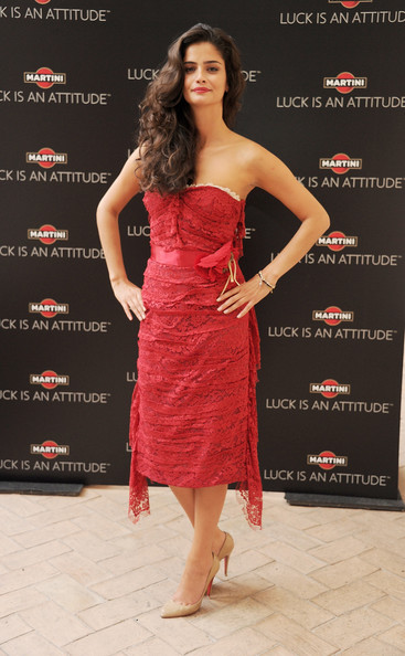 Shermine Shahrivar went subtle with her choice of shoes as she wore a pair of classic nude pumps to match her striking red dress.