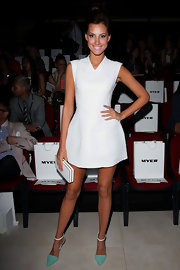 Laura Dundovic looked youthful yet sexy in a cheerleader-inspired little white dress at the Myer fashion show.