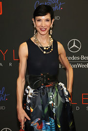 Amy Fine Collins made her navy tank top red carpet-worthy by teaming it with a chic floral skirt and plenty of bling.