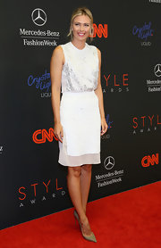 Maria Sharapova looked exquisite at the Style Awards in an embellished silver blouse and a sheer-panel white skirt.