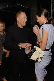 Giovanna Battaglia was spotted backstage at the Michael Kors fashion show carrying a stylish buckled black-and-white tote.