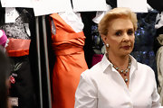 Carolina Herrera completed her classy ensemble at her Spring 2011 fashion show with a gray pearl Y-drop necklace.