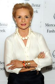 Carolina Herrera's gold bracelet watch was a luxurious addition to her ensemble during Mercedes-Benz Fashion Week.