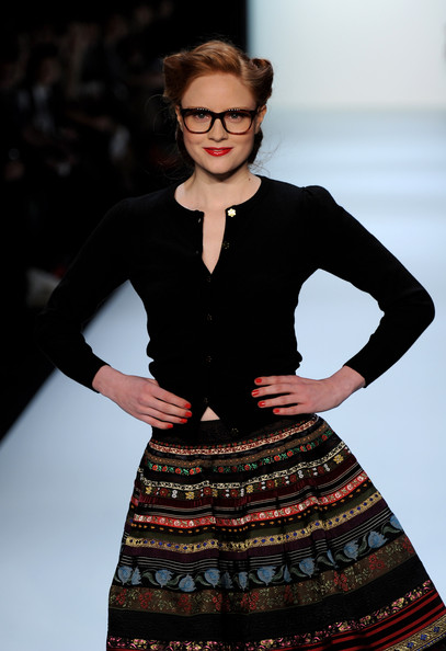 Barbara Meier looked adorable in a classic black cardigan at the Lena Hoschek Fashion Show.