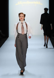 Barbara Meier strutted down the runway in high-waisted paints with suspenders at the Lena Hoschek Fashion Show.