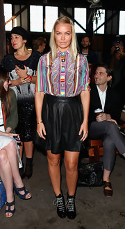 Lara Bingle arrived at the Romance Was Born fashion show wearing casual black leather lace-ups.