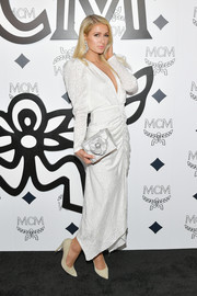 Paris Hilton glammed up in a white Ronny Kobo gown with Juliet sleeves and a ruched skirt for the MCM global flagship store opening.