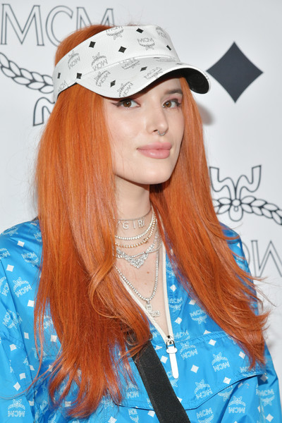 Bella Thorne added a sporty touch with a white MCM sun visor.
