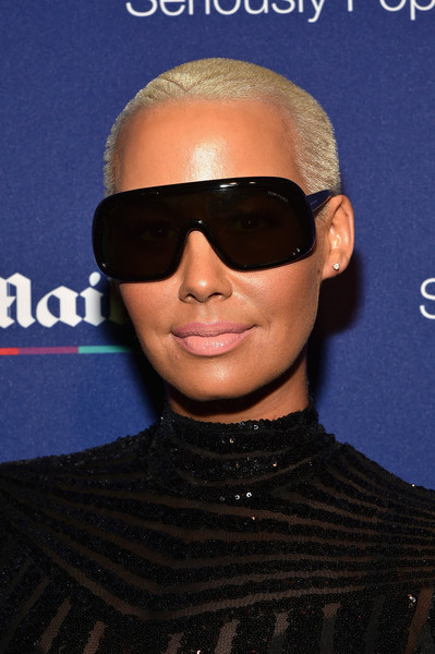Amber Rose attended the DailyMail.com Holiday Party wearing a striped buzzcut.
