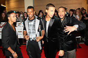 Oritse Williams showed his zany fashion sense with a gray and black blazer and tuxedo-print shirt.