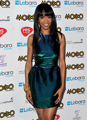 Michelle was a metallic maven while hitting the MOBO Awards in an iridescent green dress.