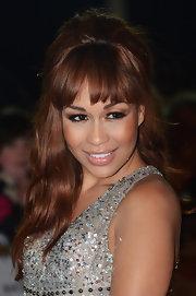 Rebecca Ferguson topped off her Brit Awards look with a retro-chic half-up half-down 'do.